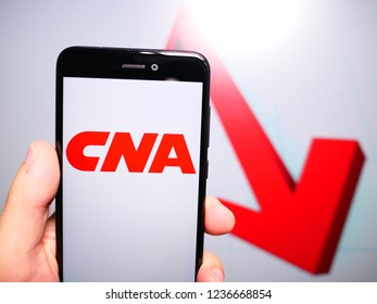 Murcia, Spain; Nov 19, 2018: CNA Financial Corporation logo in phone with losses graphic on background. First person view