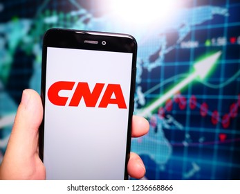 Murcia, Spain; Nov 19, 2018: CNA Financial Corporation logo in phone with earnings graphic on background. CNA Financial Corporation is a financial corporation based in Chicago, Illinois