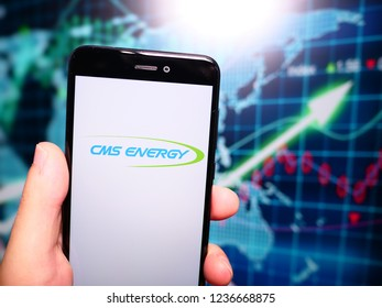 Murcia, Spain; Nov 19, 2018: CMS Energy logo in phone with earnings graphic on background. CMS Energy is an energy company that is focused principally on utility operations in Michigan
