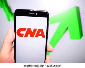 Murcia, Spain; Nov 19, 2018: CNA Financial Corporation logo in phone with rises graphic on background. First person view