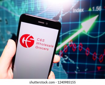 Murcia, Spain; Nov 21, 2018: C&S Wholesale Grocers logo in phone with earnings graphic on background. C&S Wholesale Grocers is an American wholesale distribution of food and grocery store