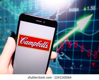 Murcia, Spain; Nov 21, 2018: Campbell Soup Company logo in phone with earnings graphic on background. Campbell Soup Company, also known as just Campbell's, is an American producer of canned soups