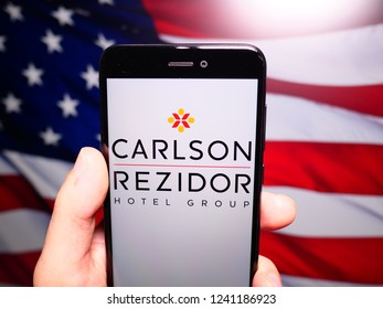 Murcia, Spain; Nov 21, 2018: Carlson Rezidor logo in phone with United States flag on background. Carlson is an American privately held international corporation