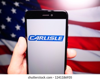 Murcia, Spain; Nov 21, 2018: Carlisle Companies logo in phone with United States flag on background. Carlisle Companies Incorporated is a global diversified company