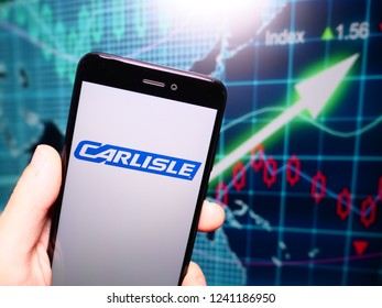Murcia, Spain; Nov 21, 2018: Carlisle Companies logo in phone with earnings graphic on background. Carlisle Companies Incorporated is a global diversified company