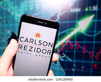Murcia, Spain; Nov 21, 2018: Carlson Rezidor logo in phone with earnings graphic on background. Carlson is an American privately held international corporation