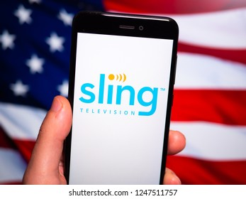 Murcia, Spain; Nov 27, 2018: Sling TV logo in phone with United States flag on background. Sling Television is an American over-the-top internet television service