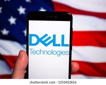 Murcia, Spain; Nov 27, 2018: Dell Technologies logo in phone with United States flag on background. Dell Technologies Inc. is an American multinational corporation in the information technology