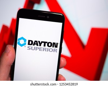 Murcia, Spain; Nov 27, 2018: Dayton Superior logo in phone with losses graphic on background. First person view