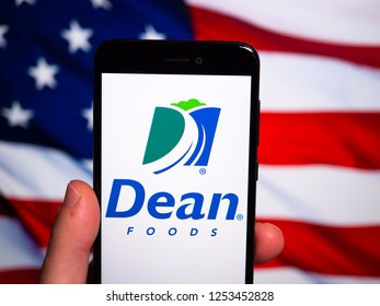 Murcia, Spain; Nov 27, 2018: Dean Foods logo in phone with United States flag on background. Dean Foods is an American food and beverage company