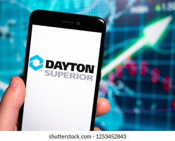 Murcia, Spain; Nov 27, 2018: Dayton Superior logo in phone with earnings graphic on background. Dayton Superior Corporation is a global[2] company serving the nonresidential concrete industry