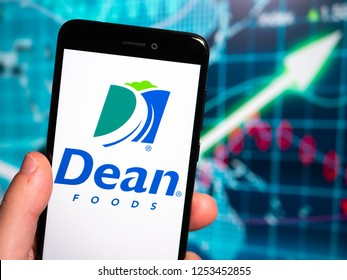 Murcia, Spain; Nov 27, 2018: Dean Foods logo in phone with earnings graphic on background. Dean Foods is an American food and beverage company
