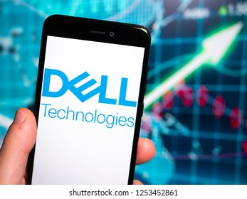Murcia, Spain; Nov 27, 2018: Dell Technologies logo in phone with earnings graphic on background. Dell Technologies Inc. is an American multinational corporation in the information technology
