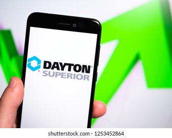 Murcia, Spain; Nov 27, 2018: Dayton Superior logo in phone with rises graphic on background. First person view