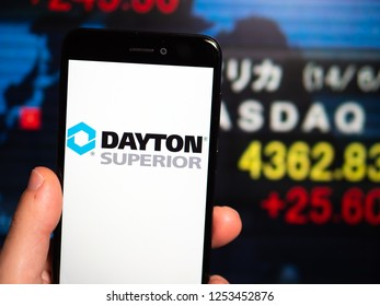 Murcia, Spain; Nov 27, 2018: Dayton Superior logo in phone with stock exchange screen on background. First person view