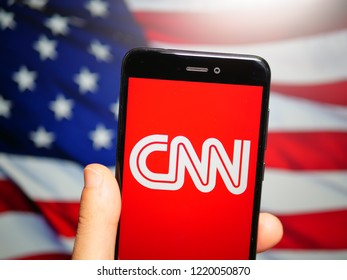 Murcia, Spain; Nov 3, 2018: CNN white logo in phone with United States flag on background. Cable News Network (CNN) is an American news-based pay television channel