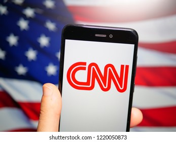 Murcia, Spain; Nov 3, 2018: CNN red logo in phone with United States flag on background. Cable News Network (CNN) is an American news-based pay television channel