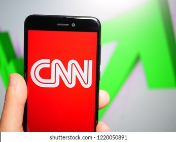 Murcia, Spain; Nov 3, 2018: CNN white logo in phone with rises graphic on background. First person view