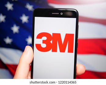 Murcia, Spain; Nov 3, 2018: 3M Company logo in phone with United States flag on background. 3M Company is an American multinational conglomerate corporation operating in industry and other fields