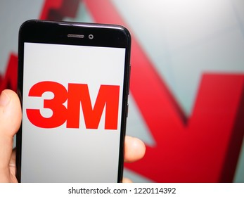 Murcia, Spain; Nov 3, 2018: 3M Company logo in phone with losses graphic on background. First person view
