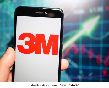 Murcia, Spain; Nov 3, 2018: 3M Company logo in phone with earnings graphic on background. 3M Company is an American multinational conglomerate corporation operating in industry, health care and others