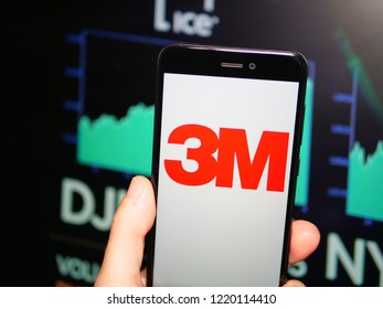 Murcia, Spain; Nov 3, 2018: 3M Company logo in phone with Dow Jones index screen on background. First person view