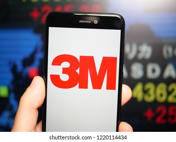 Murcia, Spain; Nov 3, 2018: 3M Company logo in phone with New York stock exchange (NYSE) screen on background. First person view