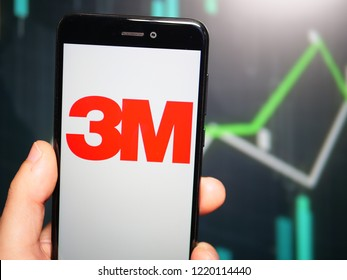 Murcia, Spain; Nov 3, 2018: Hand holding phone with 3M Company logo displayed in it with fluctuating graphic on background. First person view