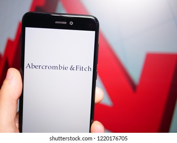 Murcia, Spain; Nov 3, 2018: Abercrombie & Fitch logo in phone with losses graphic on background. First person view