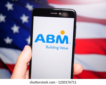 Murcia, Spain; Nov 3, 2018: ABM Industries logo in phone with United States flag on background. ABM Industries Inc. is a facility management provider in the United States