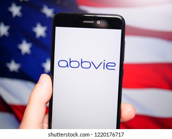 Murcia, Spain; Nov 3, 2018: Abbvie logo in phone with United States flag on background. AbbVie is a publicly traded biopharmaceutical company