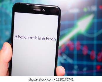 Murcia, Spain; Nov 3, 2018: Abercrombie & Fitch logo in phone with earnings graphic on background. Abercrombie & Fitch is an American retailer that focuses on upscale casual wear