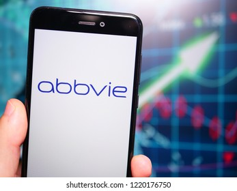 Murcia, Spain; Nov 3, 2018: AbbVie logo in phone with earnings graphic on background. AbbVie is a publicly traded biopharmaceutical company