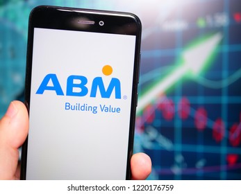 Murcia, Spain; Nov 3, 2018: ABM Industries logo in phone with earnings graphic on background. ABM Industries Inc. is a facility management provider in the United States