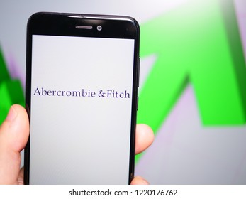 Murcia, Spain; Nov 3, 2018: Abercrombie & Fitch logo in phone with rises graphic on background. First person view