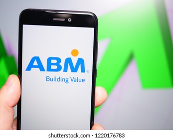 Murcia, Spain; Nov 3, 2018: ABM Industries logo in phone with rises graphic on background. First person view