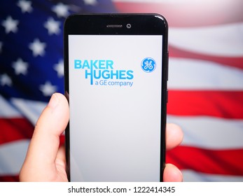 Murcia, Spain; Nov 6, 2018: Baker Hughes (BHGE) logo in phone with United States flag on background. Baker Hughes, a GE company (BHGE) is an international industrial service company
