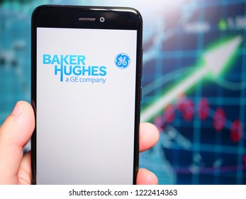 Murcia, Spain; Nov 6, 2018: Baker Hughes (BHGE) logo in phone with earnings graphic on backgorund. Baker Hughes, a GE company (BHGE) is an international industrial service company