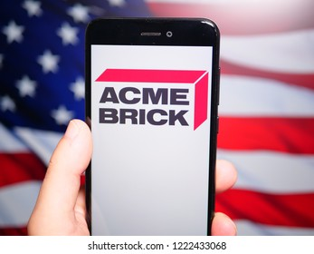 Murcia, Spain; Nov 6, 2018: Acme Brick Company logo in phone with United States flag on background. Acme Brick Company is an American manufacturer and distributor of brick and masonry-related products