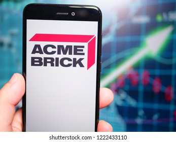 Murcia, Spain; Nov 6, 2018: Acme Brick Company logo in phone with earnings graphic on background. Acme Brick Company is an American manufacturer and distributor of brick and masonry-related products