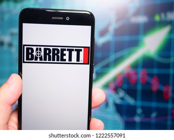 Murcia, Spain; Nov 6, 2018: Barrett Firearms Manufacturing logo in phone with earnings graphic on background. Barrett Firearms Manufacturing is an American manufacturer of firearms and ammunition