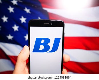 Murcia, Spain; Nov 7, 2018: BJ Services Company logo in phone with United States flag on background. BJ Services Company is a leading worldwide provider of pressure pumping and oilfield services