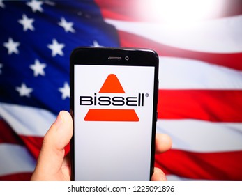Murcia, Spain; Nov 7, 2018: Bissell Homecare logo in phone with United States flag on background. Bissell Homecare, is a privately owned vacuum cleaner and floor care product manufacturing