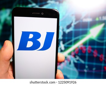 Murcia, Spain; Nov 7, 2018: BJ Services logo in phone with earnings graphic on background. BJ Services Company is a leading worldwide provider of pressure pumping and oilfield services
