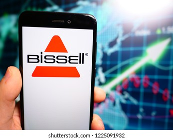 Murcia, Spain; Nov 7, 2018: Bissell Homecare logo in phone with earnings graphic on background. Bissell Homecare, is a privately owned vacuum cleaner and floor care product manufacturing