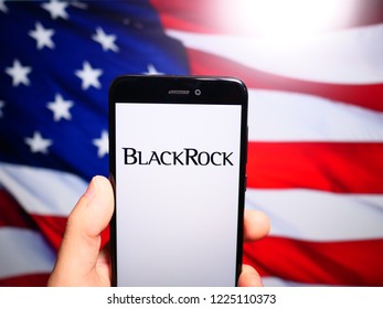 Murcia, Spain; Nov 7, 2018: BlackRock logo in phone with United States flag on background. BlackRock, Inc. is an American global investment management corporation