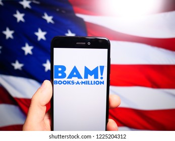 Murcia, Spain; Nov 7, 2018: Books A Million (BAM!) blue logo in phone with United States flag on background. Books a Million owns and operates the second largest bookstore chain in the United States