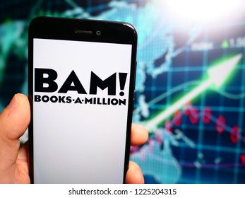 Murcia, Spain; Nov 7, 2018: Books a Million (BAM!) black logo in phone with earnings graphic on background. Books-A-Million owns and operates the second largest bookstore chain in the United States