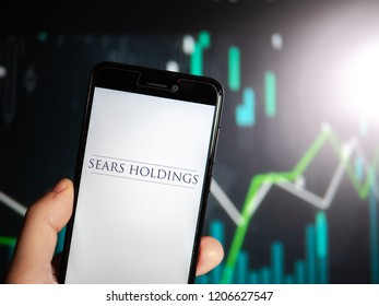Murcia, Spain; Oct 16, 2018: Sears Holdings logo in phone with fluctutating graphic on background. Sears Holding Corporation collapse