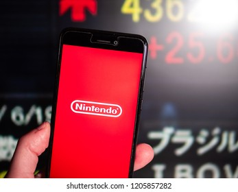 Murcia, Spain; Oct 18, 2018: Nintendo company logo in phone with stock exchange screen on background. Nintendo is one of the world's largest video game companies by market capitalization